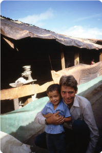 In the Mesa Grande refugee camp in Honduras, Philippe Bourgois embraces a child with whom he had hidden in a cave while fleeing the Salvadoran army in 1981. (Photo courtesy Philippe Bourgois.)