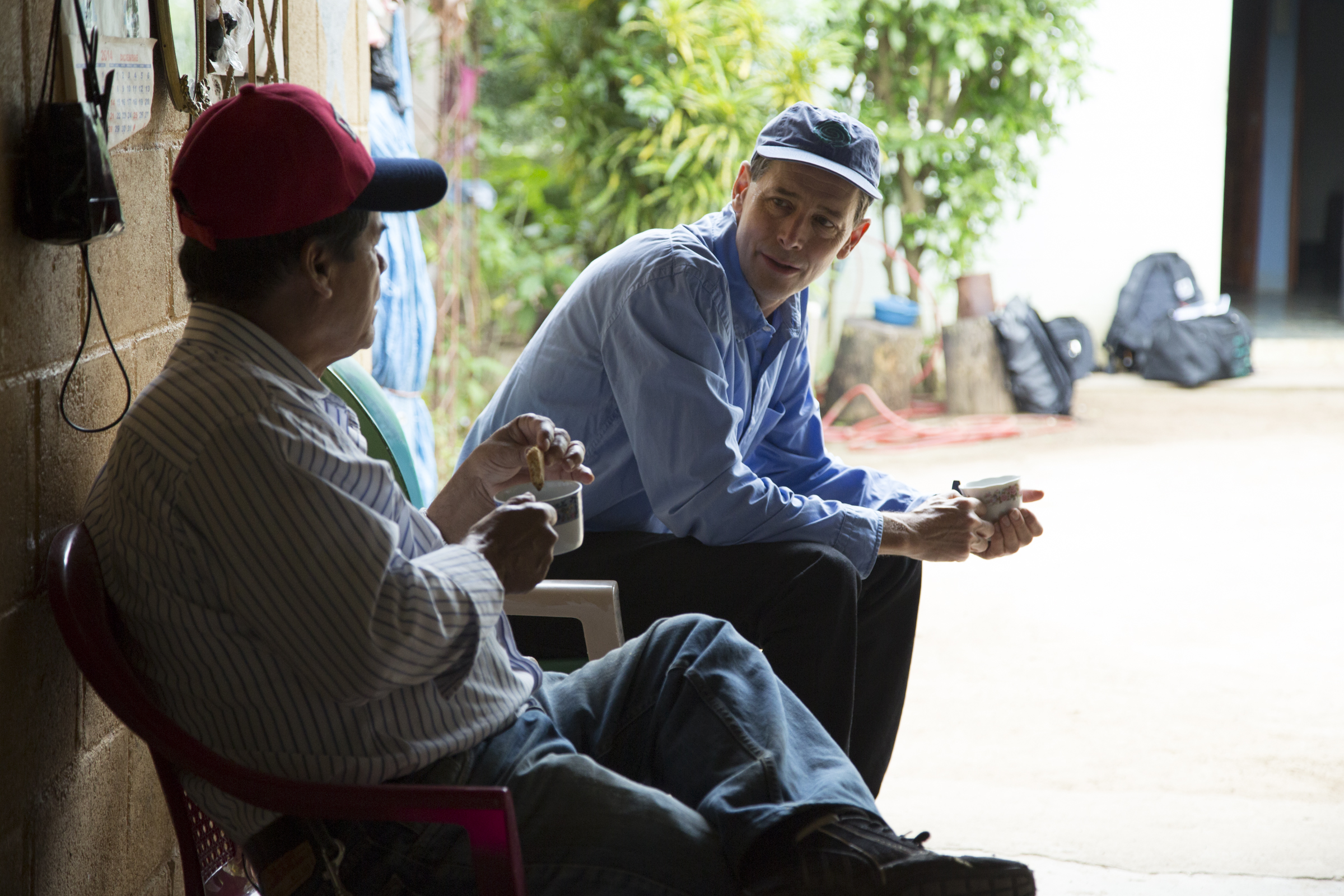 Philippe Bourgois and community member Luis Rivas converse in Santa Marta. (Photo by Alex Montalvo.)