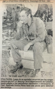 """A break. After an exhausting trek through camps destroyed by the armed forces in the department of Cabañas, showing them to national and international journalists, Coronel Sigifredo Ochoa Pérez takes a break to savor an orange."" La Prensa Gráfica, Nov. 22, 1981"